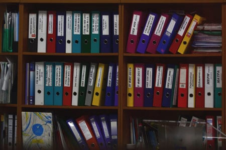 Policy and Document Management on bookcase.