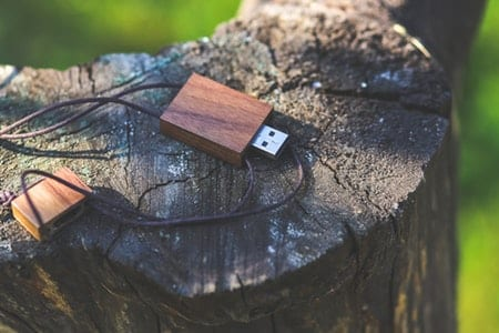 Custom wood flash drive on a tree stump.