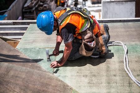 Construction worker minimizing risk